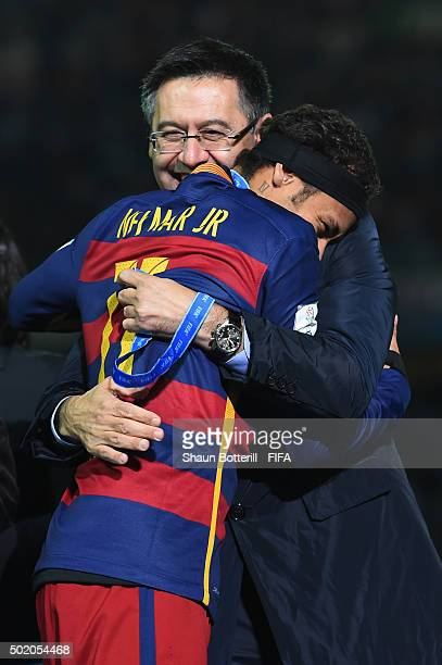 Barcelona President Josep Maria Bartomeu is hugged by Neymar of Barcelona following their team's 30 victory during the FIFA Club World Cup Final...