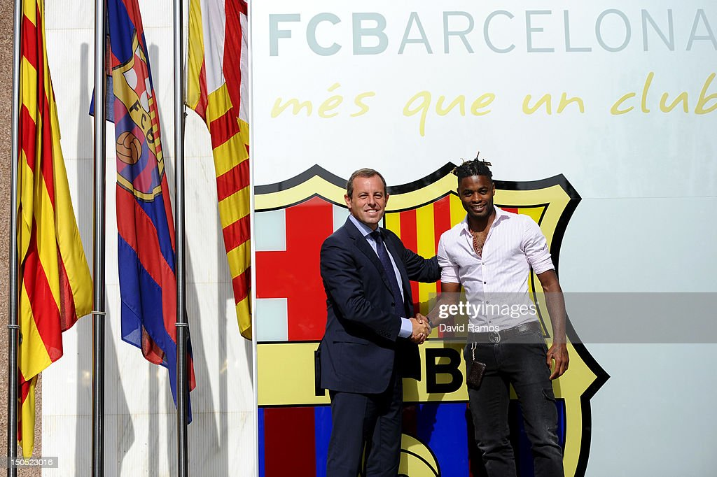 FC Barcelona President <a gi-track='captionPersonalityLinkClicked' href=/galleries/search?phrase=Sandro+Rosell&family=editorial&specificpeople=2363208 ng-click='$event.stopPropagation()'>Sandro Rosell</a> and <a gi-track='captionPersonalityLinkClicked' href=/galleries/search?phrase=Alex+Song&family=editorial&specificpeople=652067 ng-click='$event.stopPropagation()'>Alex Song</a> shake hands after signing for FC Barcelona at Camp Nou on August 20, 2012 in Barcelona, Spain.