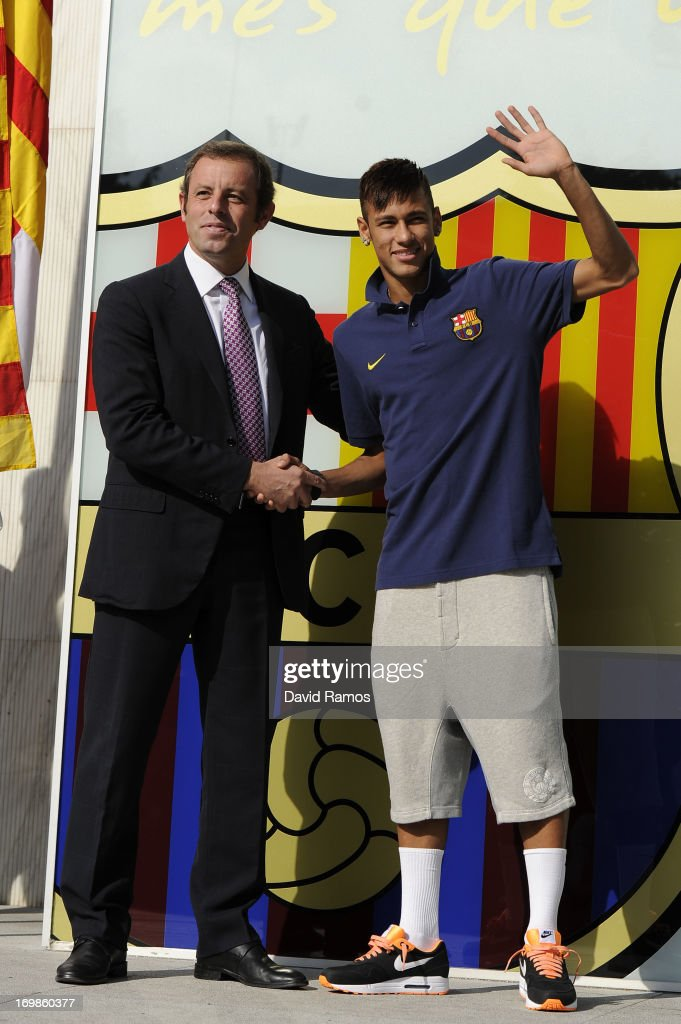 C Barcelona President <a gi-track='captionPersonalityLinkClicked' href=/galleries/search?phrase=Sandro+Rosell&family=editorial&specificpeople=2363208 ng-click='$event.stopPropagation()'>Sandro Rosell</a> and Neymar shake hands as they pose for the media during the official presentation as a new player of the FC Barcelona sports complex on June 3, 2013 in Barcelona, Spain.