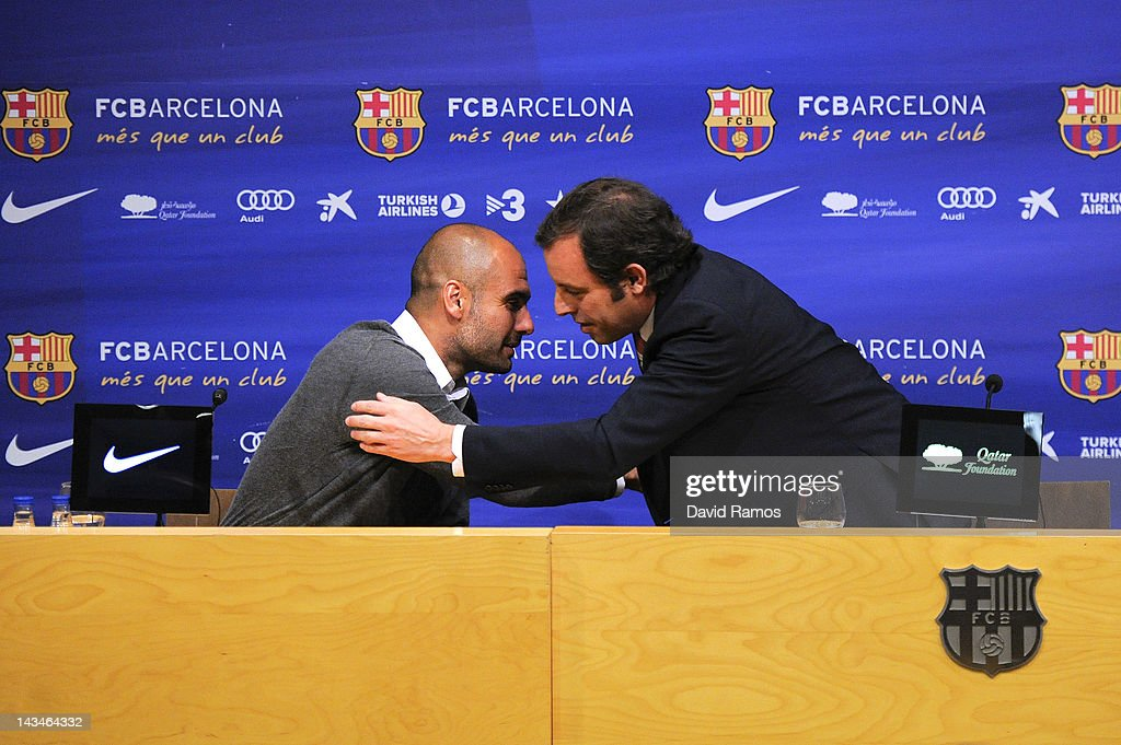 FC Barcelona President <a gi-track='captionPersonalityLinkClicked' href=/galleries/search?phrase=Sandro+Rosell&family=editorial&specificpeople=2363208 ng-click='$event.stopPropagation()'>Sandro Rosell</a> hugs Head coach <a gi-track='captionPersonalityLinkClicked' href=/galleries/search?phrase=Josep+Guardiola&family=editorial&specificpeople=2088964 ng-click='$event.stopPropagation()'>Josep Guardiola</a> during the press conference at the Camp Nou stadium on April 27, 2012 in Barcelona, Spain. <a gi-track='captionPersonalityLinkClicked' href=/galleries/search?phrase=Josep+Guardiola&family=editorial&specificpeople=2088964 ng-click='$event.stopPropagation()'>Josep Guardiola</a> has today announced he is not renewing his contract after a 4 year tenure as Head Coach of the FC Barcelona squad.