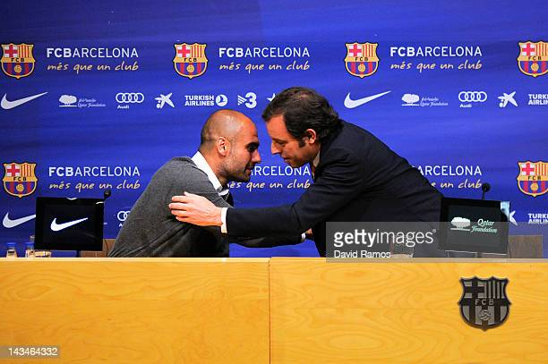 Barcelona President Sandro Rosell hugs Head coach Josep Guardiola during the press conference at the Camp Nou stadium on April 27 2012 in Barcelona...