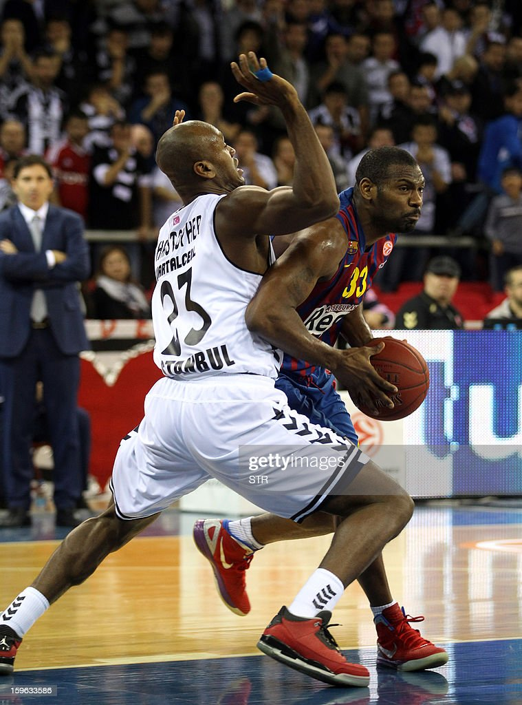 Barcelona Regal's Mete Miskeal (R) vies with Besikta's Patrick Christopher during their Euroleague Top 16 group F basketball match in Istanbul on January 17, 2013.