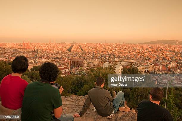 Barcelona skyline at sunset with relaxing people.