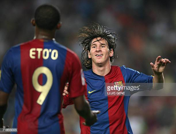 Barcelona Argentinian Leo Messi and Cameronian Samuel Eto'o celebrate their third goal against Osasuna during Spanish League match in Camp Nou...