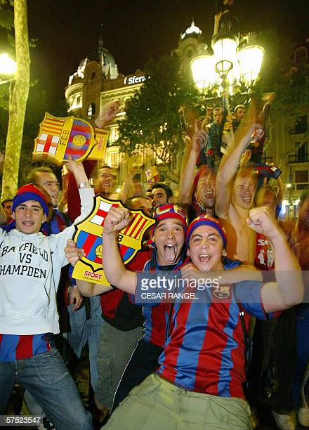 Barcelona supporters celebrate after Barcelona beat Celta of Vigo to win the Spanish football League in Barcelona 03 May 2006 AFP PHOTO CESAR RANGEL