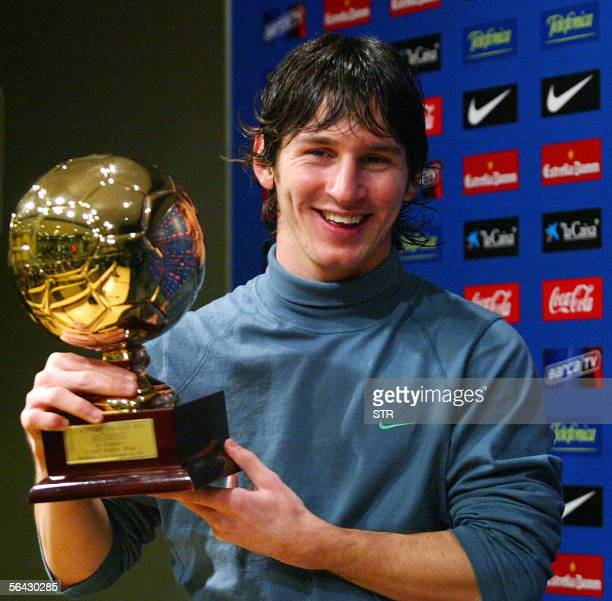 Barcelona's Argentinian forward Lionel Messi poses with his 'Golden Boy 2005' trophy awarded by Italian magazine 'Tuttosport' distinguishing the best...