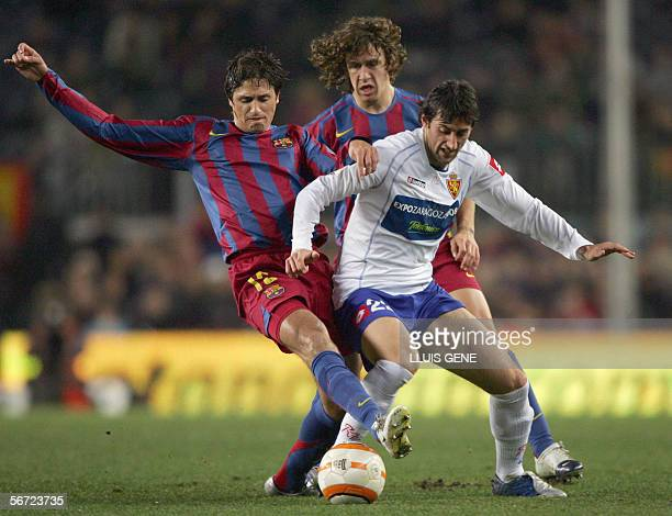 Barcelona's Brazilian Edmilson and Carles Puyol vies for the ball with Zaragoza's Zapater during their Spanish King's Cup football match at the Nou...