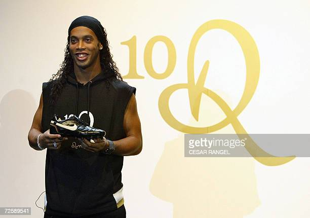 Barcelona's Brazilian striker Ronaldinho poses during the presentation of a new range of clothing by American apparel company Nike with his signature...