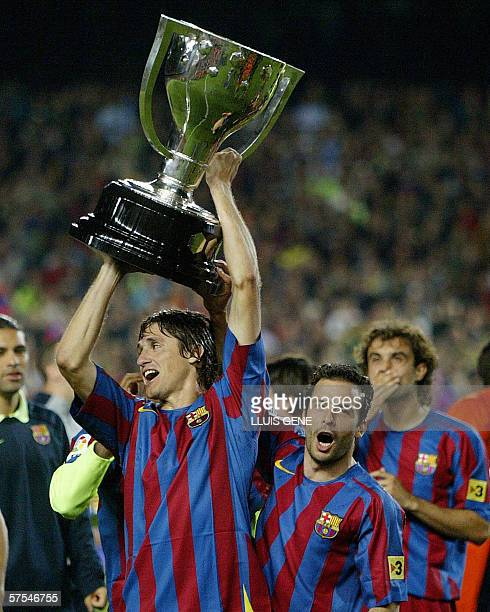 Barcelona's Edmilson and Ludovic Giuly celebrate with the League trophy after beating Espanyol in a Spanish league football match at the Camp Nou...