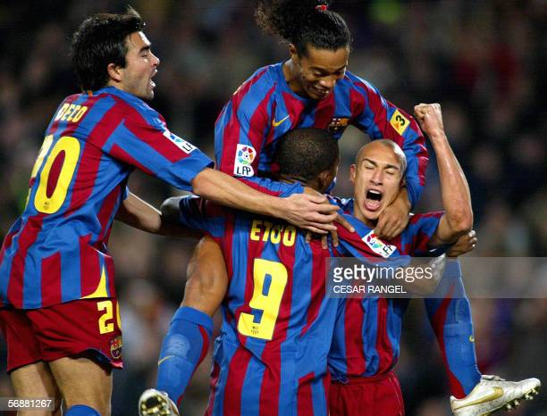 Barcelona's Henrik Larsson celebrates after scoring a goal with his team mates Deco Ronaldinho and Samuel Eto'o against Betis during their Spanish...