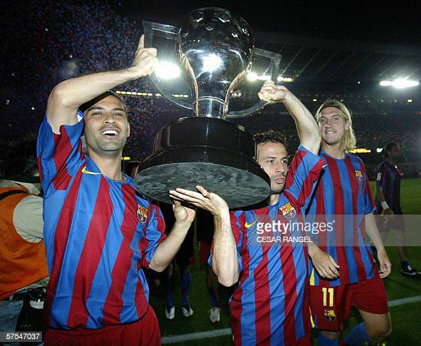 Barcelona's Mexican Rafael Marquez and French Ludovic Giuly celebrate with the League trophy after beating Espanyol and winning the Spanish league at...