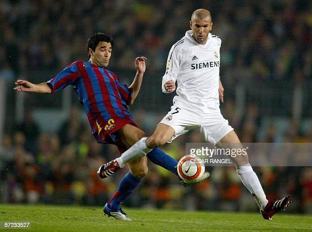 Barcelona's Portuguese Deco tackles Real Madrid's Zinedine Zidane during their Spanish league football match at the Camp Nou Stadium in Barcelona 01...