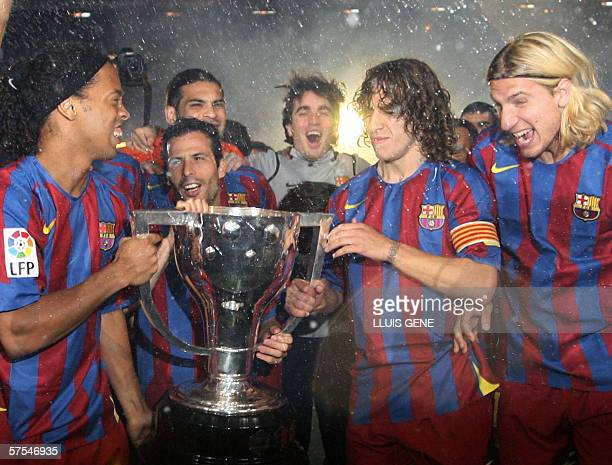 Barcelona's Ronaldinho and captain Carles Puyol celebrates with the cup after beating Espanyol and winning the Spanish league at the Camp Nou stadium...