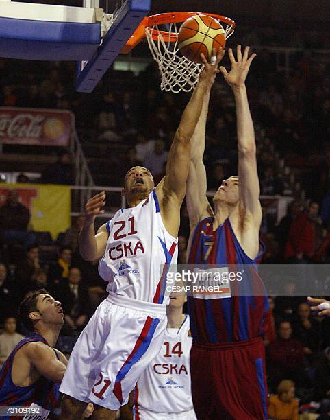 CSKA Moscow's Trajan Langdon goes for a basket by Barcelona's Francisco Vazquez during a Euroleague basketball match at the Palau Blaugrana in...