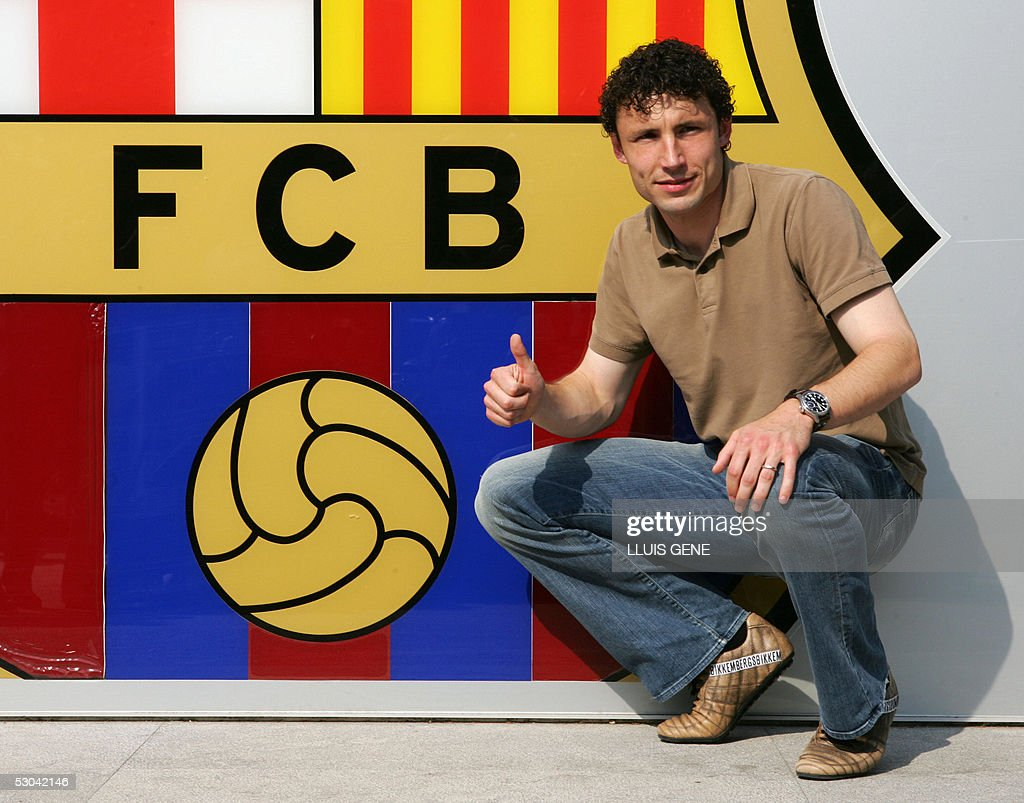 http://media.gettyimages.com/photos/barcelona-spain-dutch-mark-van-bommel-poses-for-the-photographers-at-picture-id53042146