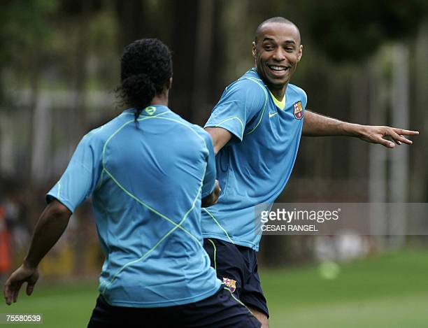 FC Barcelona's Brazilian palyer Ronaldinho and French striker Thierry Henry take part in a first training session at the Camp Nou Stadium in...