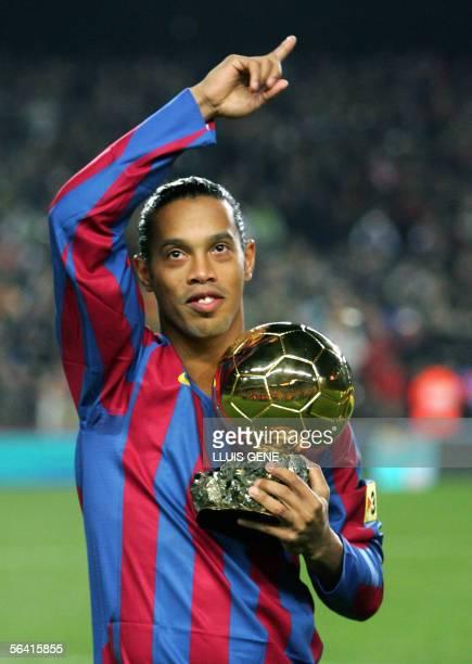 FC Barcelona's Brazilian Ronaldinho shows his 'Ballon d'or' trophy before the Spanish League football match against Sevilla CF at the Camp Nou...