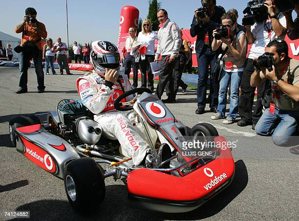 McLaren's Spanish Formula One driver Fernando Alonso takes part in an exhibition gocart race at a carting track in Montmelo near Barcelona 10 May...