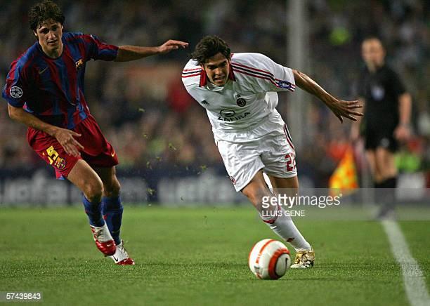 Milan's Brazilian Kaka runs past Barcelona's Brazilian Edmilson during their Champions League semifinal second leg football match at the Camp Nou...