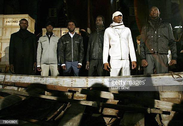 Senegalese illegal immigrants pose in front of a boat during Antonio Miro's Autumn/Winter 20078 collection during the Pasarela Barcelona in Barcelona...