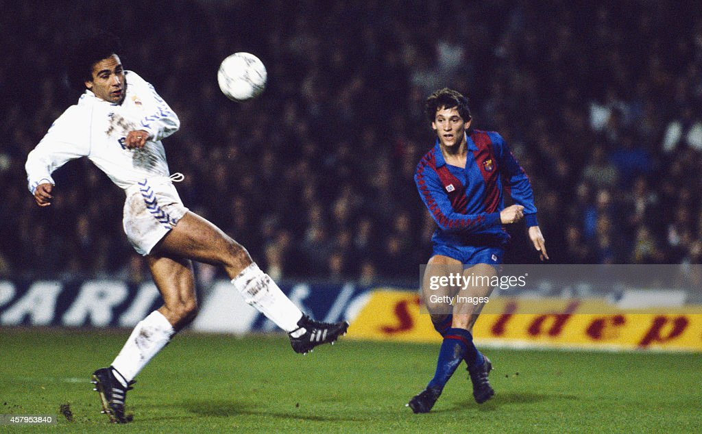 Barcelona striker Gary Lineker gets in a shot as Hugo Sanchez of Real Madrid looks on during the 'El Clasico' between Barcelona and Real Madrid at...