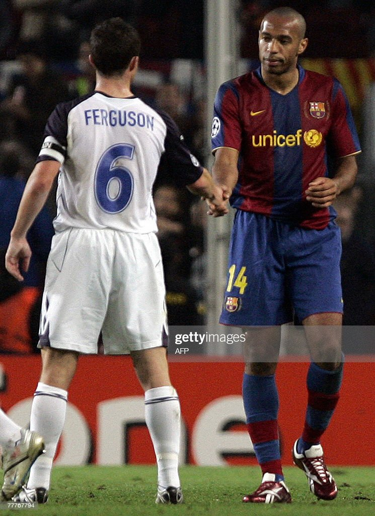 Barcelona striker Thierry Henry shakes hands with Glasgow Rangers' Ferguson after a Champions League Group E football match at the Camp Nou stadium...