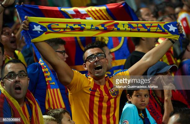 Barcelona supporter hold ProIndependence Catalan scarf during the La Liga match between Girona and Barcelona at Municipal de Montilivi Stadium on...