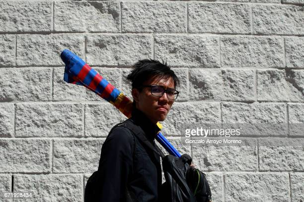 Barcelona supporter makes his way to the stadium prior to the La Liga match between Real Madrid CF and FC Barcelona at Estadio Bernabeu on April 23...
