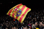 Barcelona supporter waves a Catalan flag with the FC Barcelona emblem during the La Liga match between FC Barcelona and Villarreal CF at Camp Nou on...