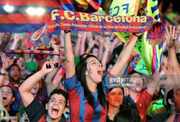 Barcelona supporters celebrate after winning the matchduring the Champions League final football match beetwen Barcelona and Manchester United on May...