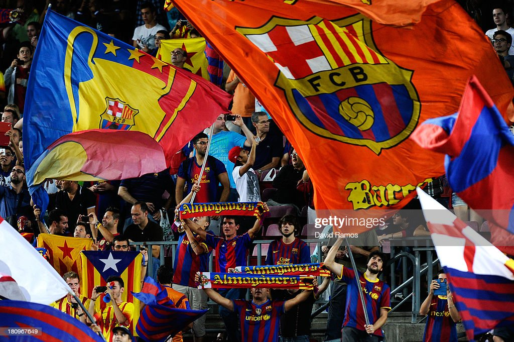 FC Barcelona supporters cheer their team during the UEFA Champions League Group H match between FC Barcelona and Ajax Amsterdam ag the Camp Nou stadium on September 18, 2013 in Barcelona, Spain.