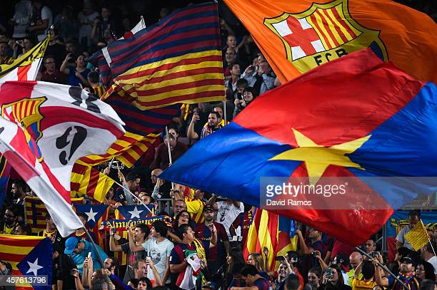 Barcelona supporters cheer up on their team prior to a UEFA Champions League Group F match between FC Barcelona and AFC Ajax at the Camp Nou Stadium...