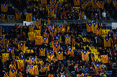 Barcelona supporters hold ProIndependence Catalan flags during the UEFA Champions League Group E match between FC Barcelona and FC BATE Borisov at...