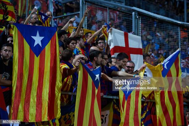 Barcelona supporters hold ProIndependence Catalan flags prior to the the La Liga match between Girona and Barcelona at Municipal de Montilivi Stadium...