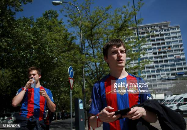 Barcelona supporters make their way to the stadium prior to the La Liga match between Real Madrid CF and FC Barcelona at Estadio Bernabeu on April 23...
