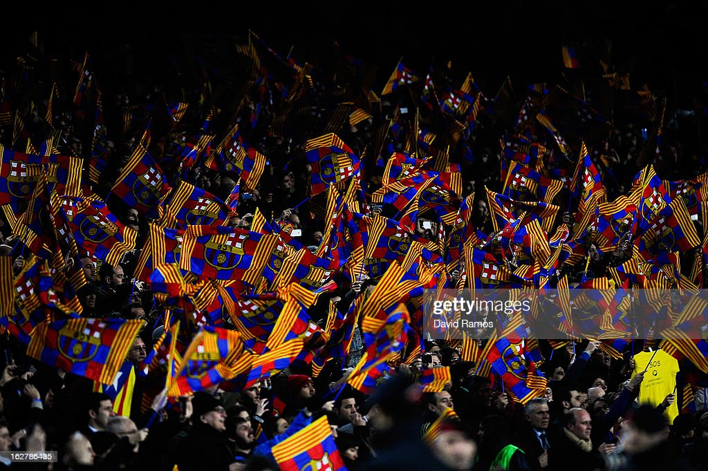 FC Barcelona supporters wave flags during the Copa del Rey Semi Final second leg between FC Barcelona and Real Madrid at Camp Nou on February 26, 2013 in Barcelona, Spain.