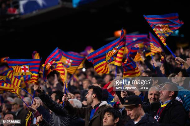 Barcelona supporters wave their flags during the UEFA Champions League Round of 16 second leg match between FC Barcelona and Paris SaintGermain at...