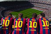 Barcelona supporters wearing Lionel Messi shirts watch the game from the stands during the La Liga match between FC Barcelona and Rayo Vallecano de...