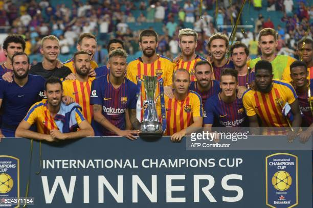 Barcelona team receives the trophy of the International Champions Cup football match at Hard Rock Stadium on July 29 2017 in Miami Florida after won...
