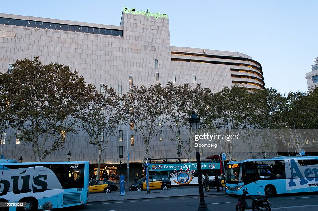 A Barcelona tourist bus and airport buses are seen outside the El Corte Ingles department store at Plaza Catalunya in Barcelona, Spain, on Tuesday, Nov. 20, 2012. Bank of Spain Governor Luis Maria Linde said the government risks missing its budget targets this year and next, adding to doubts on Prime Minister Mariano Rajoy's ability to cut the deficit amid a five-year slump. Photographer: Stefano Buonamici/Bloomberg via Getty Images