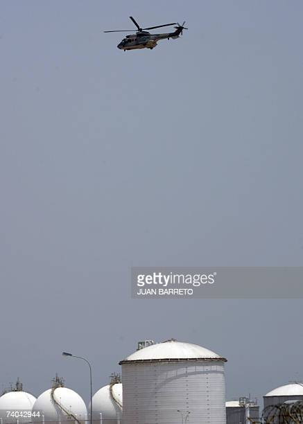 A Russianmade Mi17 Venezuelan military helicopter overflies the Jose Antonio Anzuategui industrial complex 01 May 2007 in Barcelona Venezuela...
