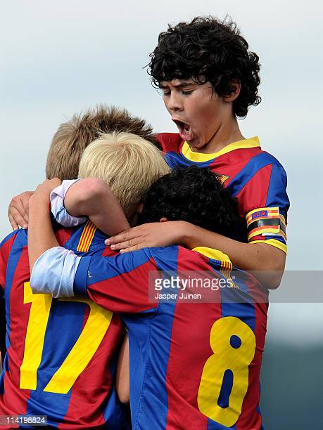 Barcelona youth players celebrate a goal during their match against Espanyol on one of the pitches at the Joan Camper training ground on May 15 2011...