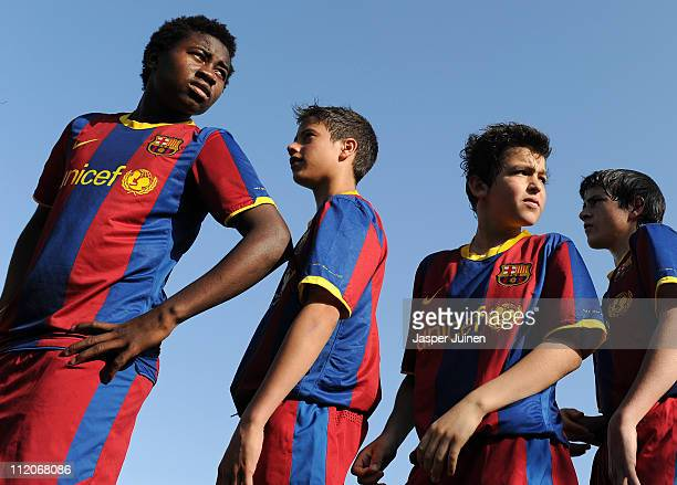 Barcelona youth players stand ready to play a match on one of the pitches at the Joan Camper training ground on April 10 2011 in Barcelona Spain...