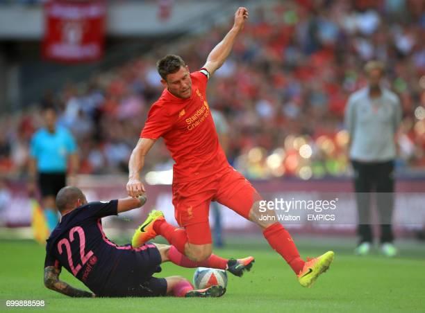Barcelona's Aleix Vidal challenges Liverpool's James Milner