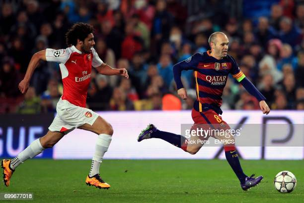 Barcelona's Andres Iniesta gets away from Arsenal's Mohamed Elneny
