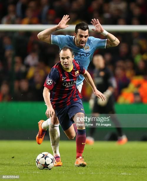 Barcelona's Andres Iniesta gets past Manchester City's Alvaro Negredo