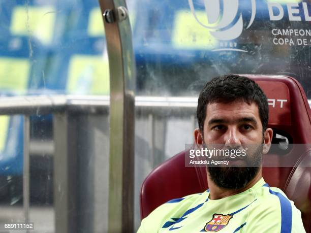 Barcelona's Arda Turan sits in the bench ahead of the Copa Del Rey Final between FC Barcelona and Deportivo Alaves at Vicente Calderon Stadium on May...