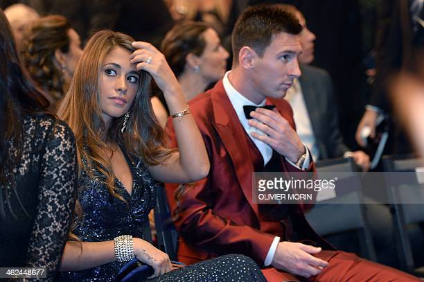 Barcelona's Argentine forward Lionel Messi and his partner Antonella Roccuzzo attend the 2013 FIFA Ballon d'Or award ceremony at the Kongresshaus in...
