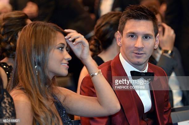 Barcelona's Argentine forward Lionel Messi and his partner Antonella Roccuzzo attend the 2013 FIFA Ballon d'Or award ceremony at the Kongresshaus in...