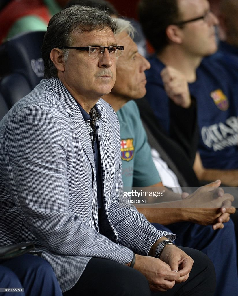 Barcelona's Argentinian coach Gerardo 'Tata' Martino looks on during the Spanish league football match FC Barcelona vs Real Valladolid CF at the Camp Nou stadium in Barcelona on October 5, 2013. AFP PHOTO / LLUIS GENE